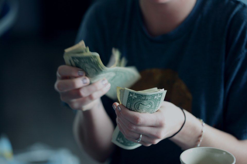 A photo of a women counting cash