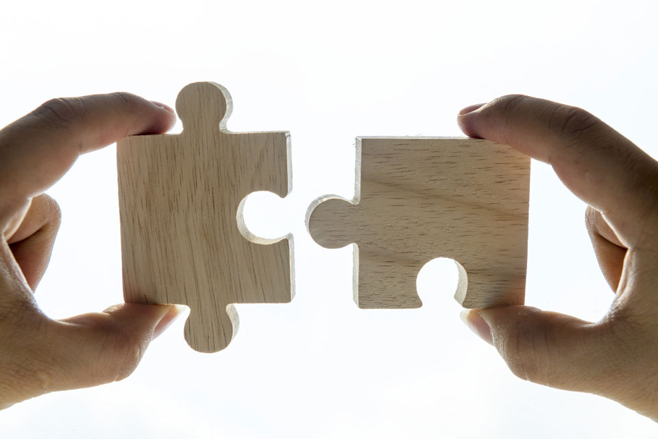 Two puzzle pieces matching together like a payment and an expense in bank reconciliation