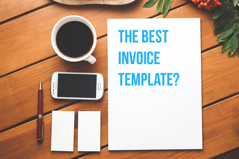 This coffee, cell phone and blank piece of paper on a desk are asking you what the best invoice template should look like