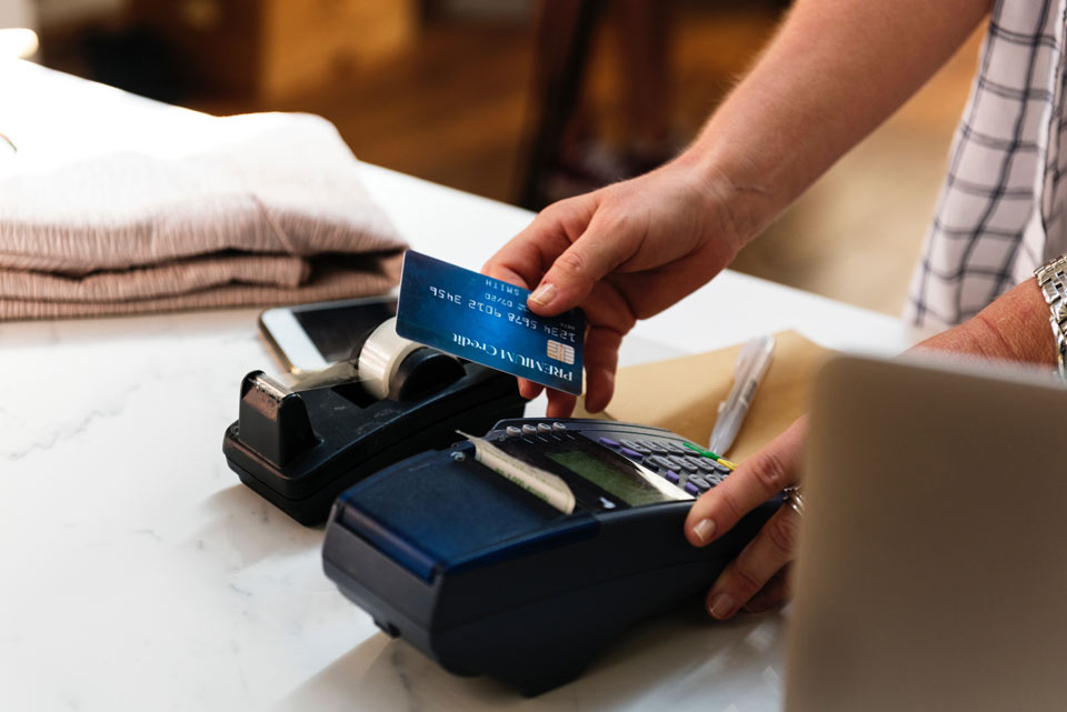 A cash register and credit card