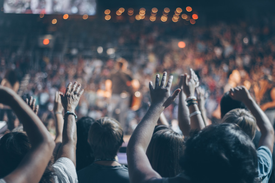 selectively focused picture of an audience at a concert. Get an overall picture when figuring out your audience